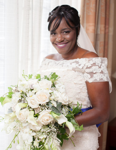 Bride holding her bouquet as she gets ready for her wedding