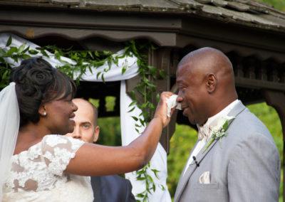 Bride wipes away the groom's tears