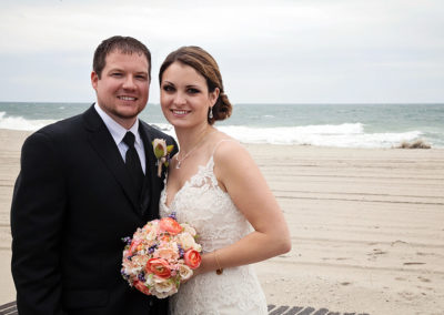 Bride and Groom posing for their wedding pictures on the beach in Cape May, NJ