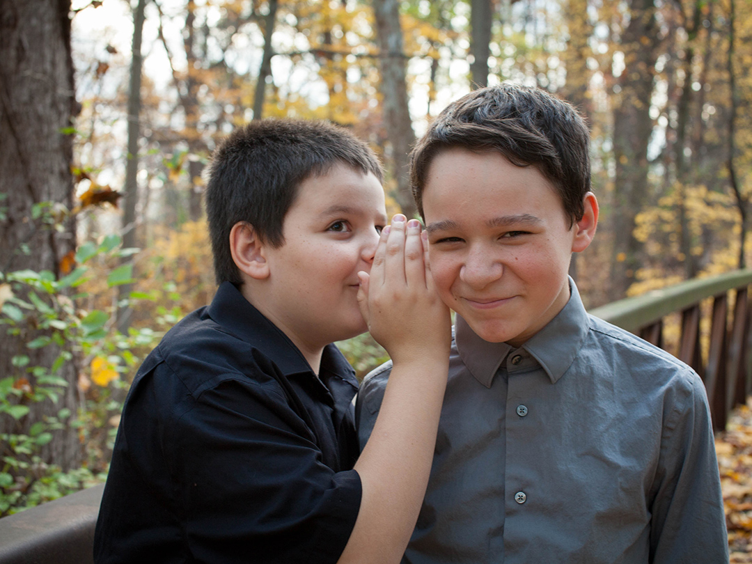 Brothers telling jokes during a kids portrait session