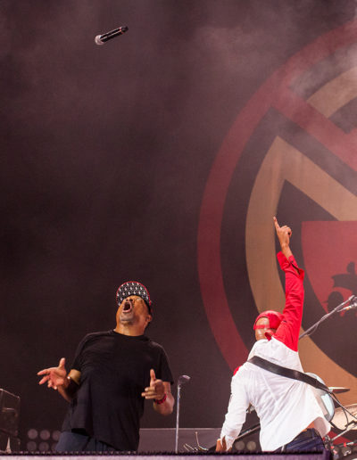 Chuck D of Public Enemy performing with Prophets of Rage throwing his mic high in the air