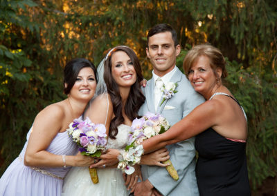 Bride, Groom and her family posing for wedding portrait at La Luna in Bensalem, PA